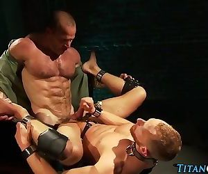 Caged buff guy cummed on